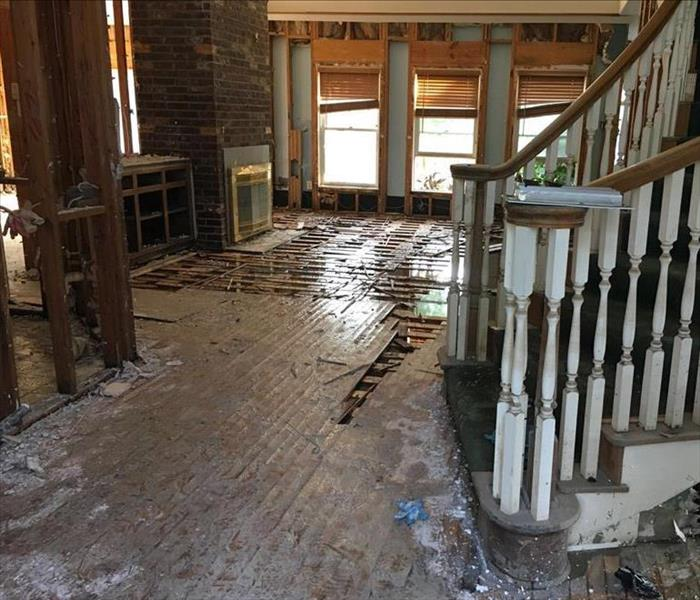 flooded family room with staircase