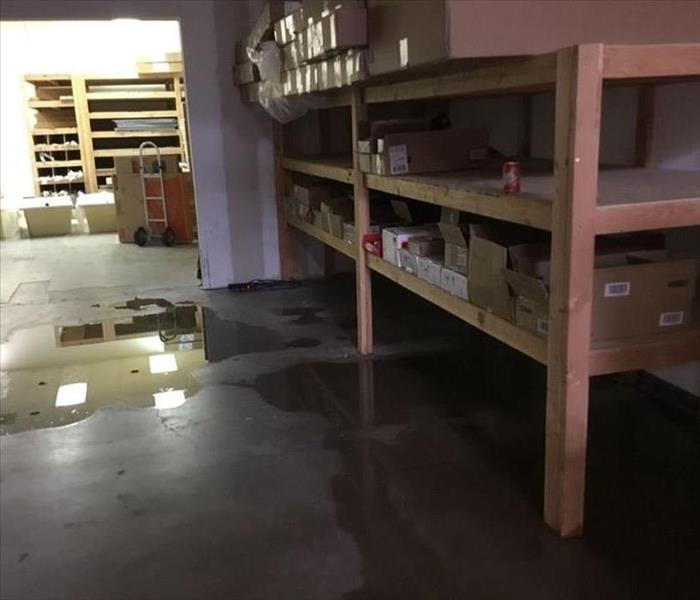 water on concrete flooring in a warehouse facility