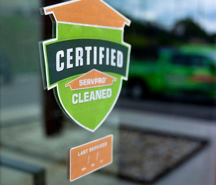 Certified: SERVPRO Cleaned in white letters on a green and orange sticker