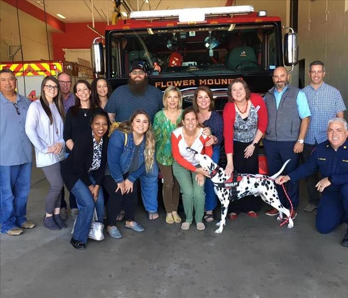 Leadership Flower Mound Class standing in front of the Flower Mound fire truck